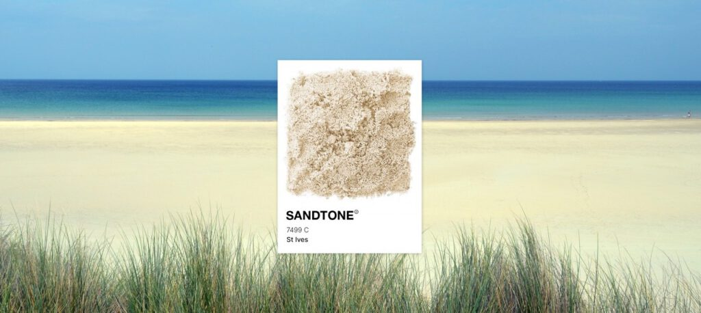 Picture of a beach with a card highlighting the colour of the sand